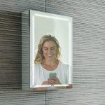 HIB Groove Bluetooth LED Illuminated Mirror Cabinet 500 x 700mm Lifestyle phone